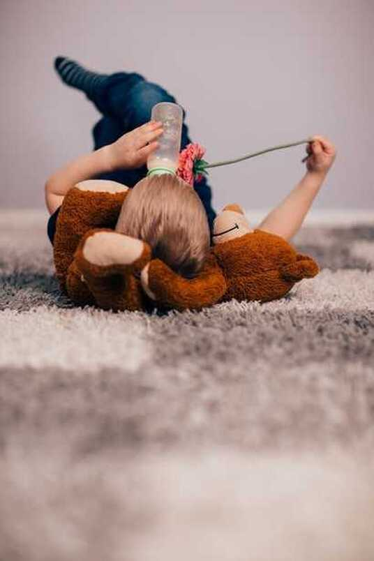 Young Boy On Carpet With Teddy Bear on Carpet