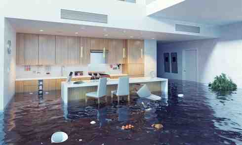 A kitchen setting flooded with water